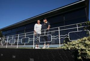 Tom and Mary Gear bask in the sun on the deck of their earthquake-proof steel home. Joel Ford.
